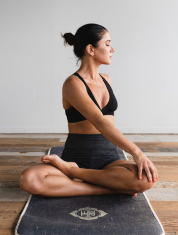 A woman practicing yoga on a mat