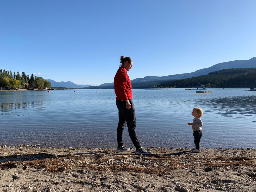 Woman and toddler overlooking a lake.