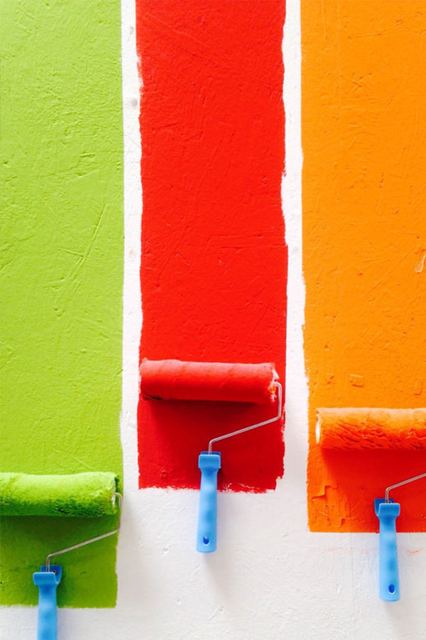 Paint rollers on a wall.
