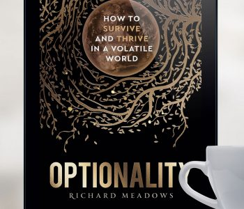 Optionality book on e-reader with cup of tea.